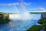 Summer view of the Canadian side of Niagara Falls with beautiful rainbow, Ontario, Canada