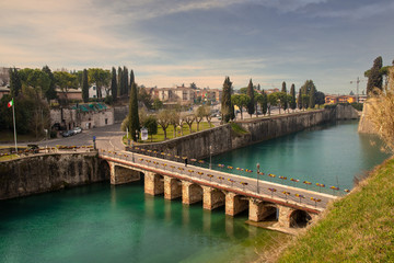 High angle view of the bridge of the fortress of Peschiera del Garda, a massive Venetian defensive system become Unesco World Heritage Site in 2017, Lake Garda, Lombardy, Italy