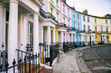 Fototapeta Fototapeta Londyn - Scenic London, England view with pastel colored buildings on an empty curved street © lazyllama