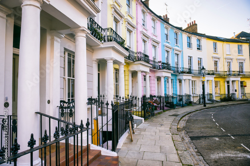 Scenic London, England view with pastel colored buildings on an empty curved street