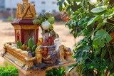 Small praying house with many offering