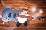 Proud man raising his electric guitar