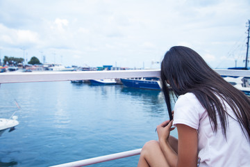 Woman on the yacht. Sitting and thinking