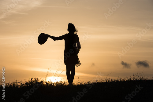 Woman with hat silhouette