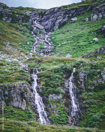 waterfall in the mountains © Adam