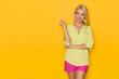 canvas print picture - Smiling Beautiful Blond Woman In Yellow Shirt And Pink Shorts