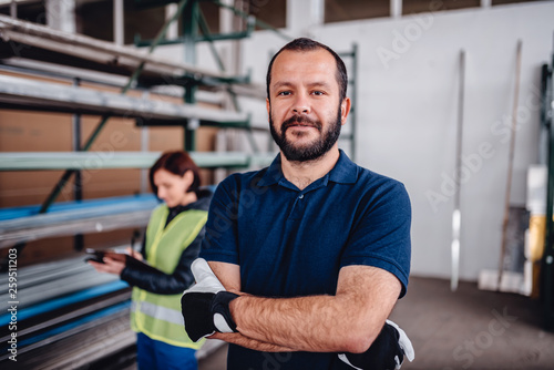 Leinwandbild Motiv Portrait of warehouse worker looking at camera