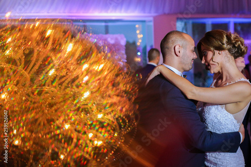 Beautiful wedding couple dancing on their wedding