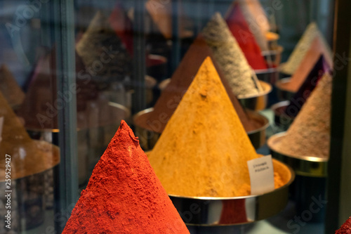 many different spices for sale at the market © Andrea Izzotti