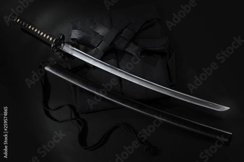 Japanese katana samurai sword. Aikido hakama, martial arts uniform © Vladimir