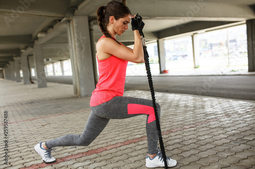 fototapeta na ścianę Young female work out on trx,suspension trainer.Outdoor workout.