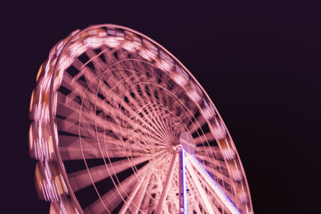 red lights of ferris wheel at night