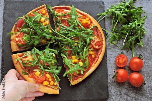 Vegan pizza with fresh arugula, corn and tomatoes. Healthy pizza. - 259639208