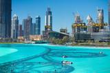 The Dubai fountain lake in the day
