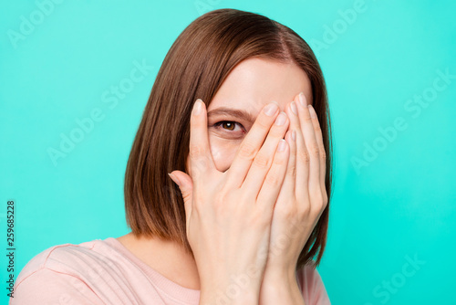 Leinwandbild Motiv Close up photo beautiful amazing her she lady hiding laugh laughter facial expression hands arms palms look through opened fingers childish play wear casual t-shirt isolated teal turquoise background
