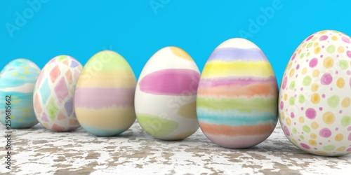 Leinwanddruck Bild Colored Easter Eggs Wooden Table