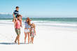 Leinwandbild Motiv Family walking at beach