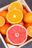 Fresh orange, grapefruit and mandarins in wooden box. Fruits as source minerals and vitamins
