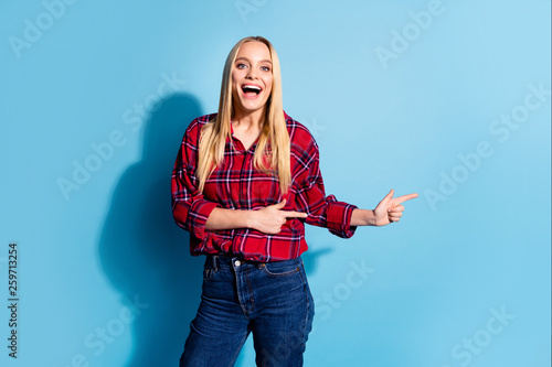 Leinwandbild Motiv Portrait of cheerful trendy satisfied student impressed astonished news information give advice choice feedback attention option decide advert dressed plaid denim outfit isolated blue background