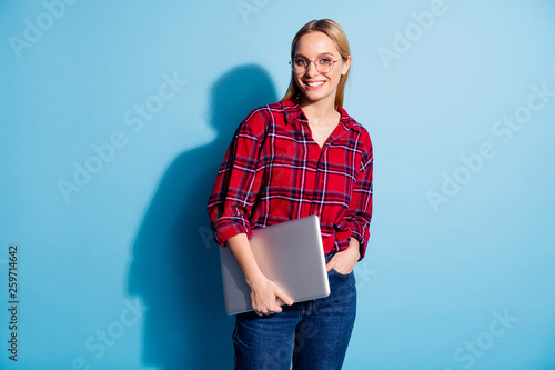 Leinwandbild Motiv Portrait of nice charming cute attractive winsome cheerful cheery teen girl wearing checked shirt carrying laptop isolated on teal turquoise bright vivid shine background