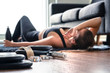 Leinwandbild Motiv Tired after exercise and workout. Overtraining concept. Exhausted woman lying on floor breathing and resting after heavy cardio training in home gym. Sad fitness athlete. Too much working out.