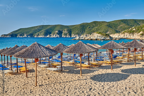 Beach with loungers and umbrellas in Greece - 259724252