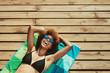 Woman in bikini relaxing at the beach