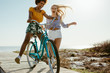 Cheerful girls having fun with a cycle