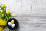 Easter eggs and flowers background