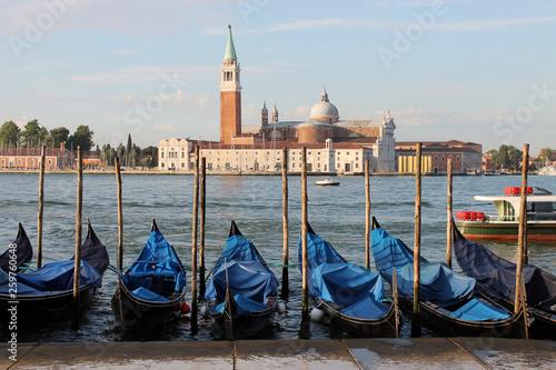 View of the island of San Giorgio Maggiore in Venice Italy with gondolas © Inna Polekhina