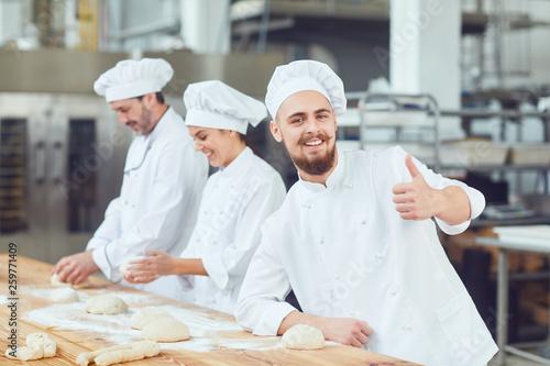 Leinwandbild Motiv Bearded male baker at the bakery.