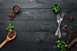 Cooking banner. Kitchen board, spices and cutlery. Top view. Free space for your text. Rustic style. - 259776860