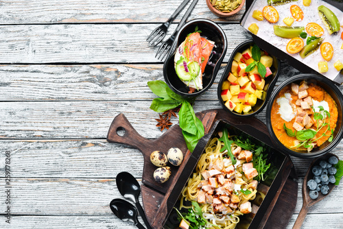 restaurant dish delivery. Catering, dinner dishes in boxes. Top view. Free space for your text. Rustic style.