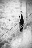 Fototapeta Fototapety na drzwi - Woman on ancient stairs background © Elina Leonova