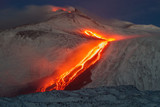 Etna volcano - lava flows and strombolian explosions from Southeast Crater - Snow landscape