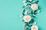 Beautiful white flowers composition on blue background