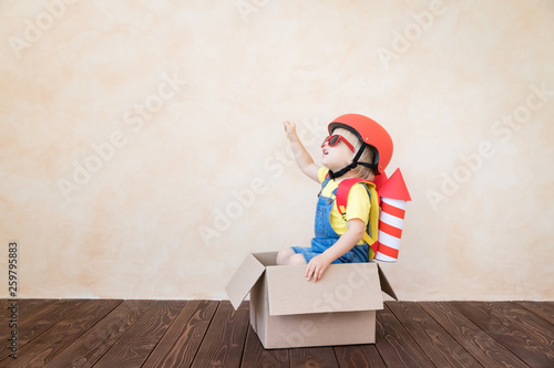 Kid playing with toy rocket at home © Sunny studio