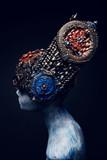 Head of woman mannequin in blue decorated kokoshnick, black studio background