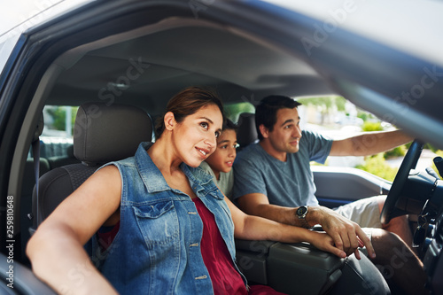fototapeta na ścianę hispanic family with mother, father and son sitting in truck looking outside