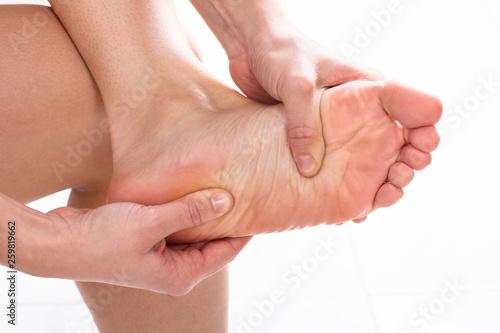 Leinwandbild Motiv Woman Having Feet Massage