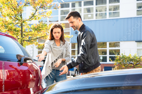 canvas print picture Man And Woman Arguing With Each Other After Car Accident