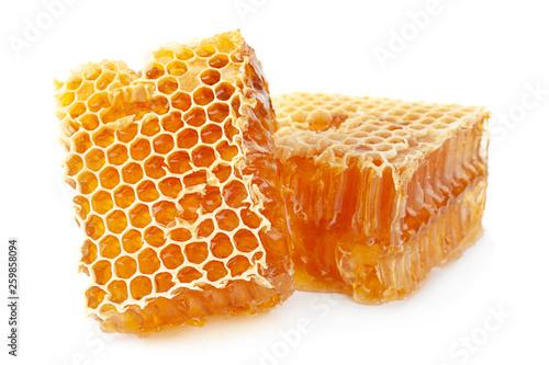 Leinwandbild Motiv Honeycomb slice closeup on white