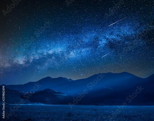 Milky way over Castelluccio at night, Umbria, Italy
