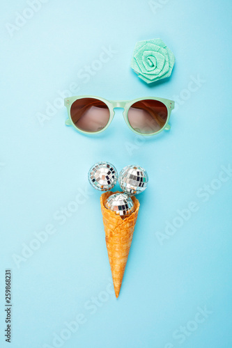 Flat lay with disco balls in the ice cream cone - 259868231