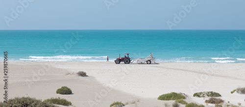 tractor on the beach - 259870665