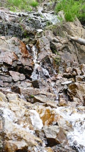 Waterfall among stones and rocks - 259905239