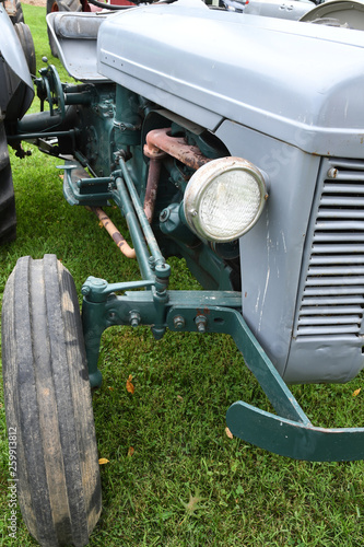Gray tractor showing headlamp and grill