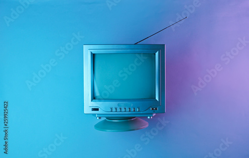Retro wave, 80s. Old tv with antenna in holographic light. Top view, minimalism © splitov27