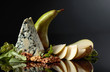 Leinwandbild Motiv Blue cheese with walnuts, pear and greens.