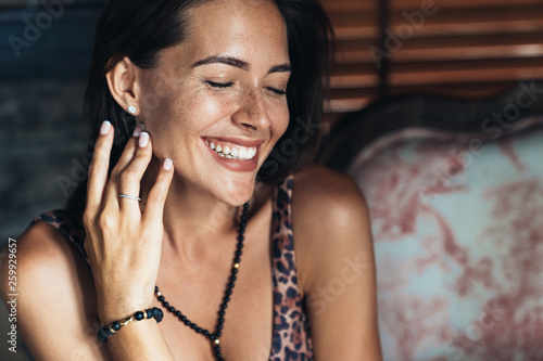 canvas print picture Portrait of happy brunette girl with beautiful smile and natural make-up